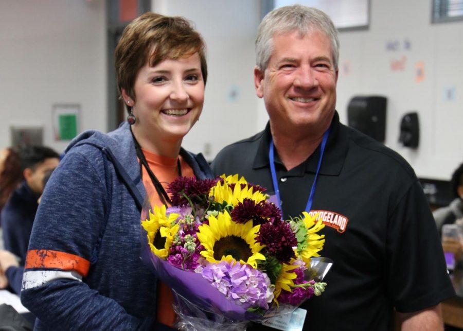 Principal Mike Smith surprises Dr. Elizabeth Braun in her classroom Jan. 12.