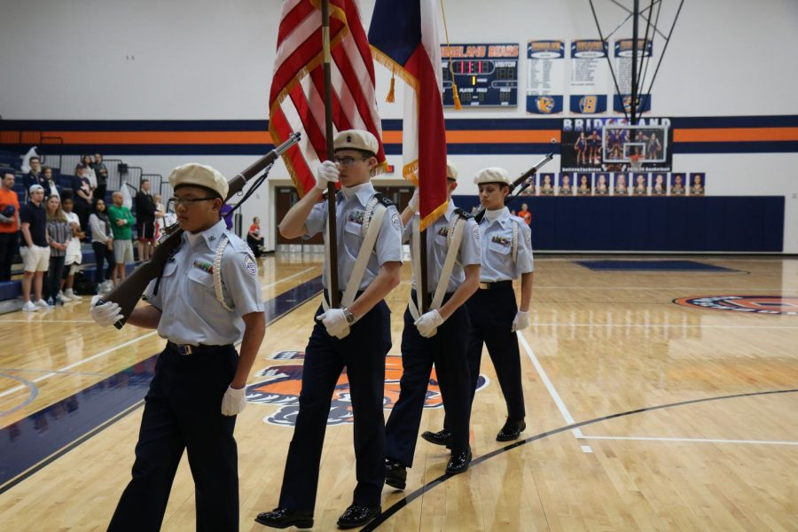 JROTC cadets present the flags at a home girls basketball game on Jan. 22, 2019.
