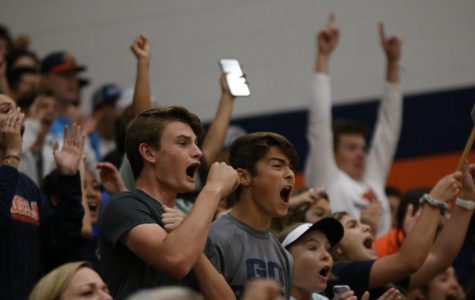 During the second set, juniors Eric Munstereifel and Ethan Hajdik scream after the Bears score a point.
