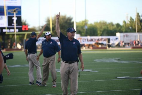 Coach Raffield celebrates a touchdown against Cy Ranch.