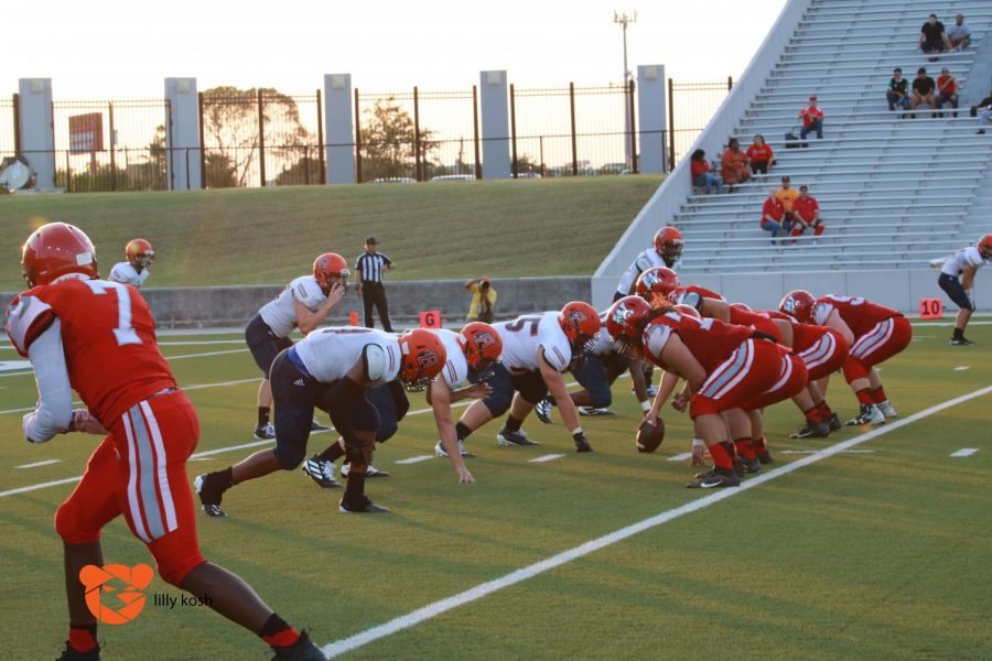 The defense prepares for a stop against Waltrip.