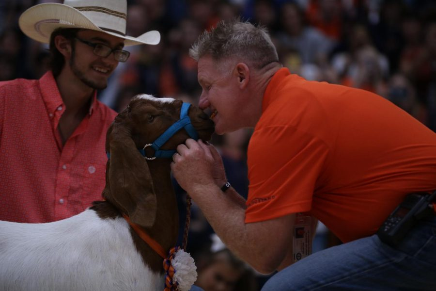 Assistant principal Donald Stanton puckers up with a cheeto to kiss Ranger.