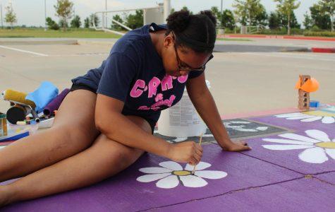 First graduating class paints parking spots