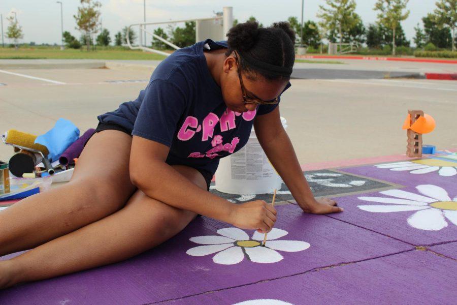 Senior Cassidy Howard paints her spot.