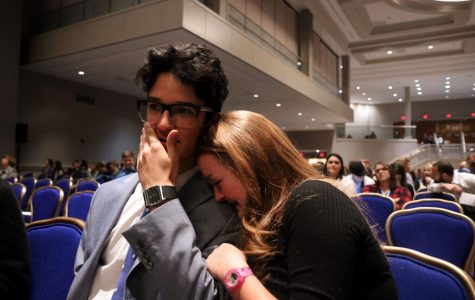 Junior Cara Hudson and junior Tommy Yarrish share emotional moment after receiving their national finalist awards. Yarrish placed second in Social Media Reporting.
