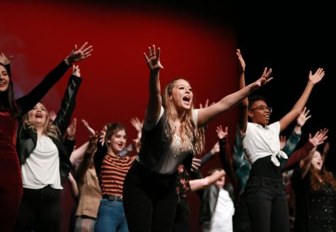 Junior Abbie Benton leads the choir in the closing group number which was a mashup of popular songs through the decades.