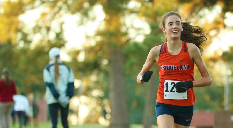 Sophomore Emily Ellis runs toward victory in the district varsity cross country meet.