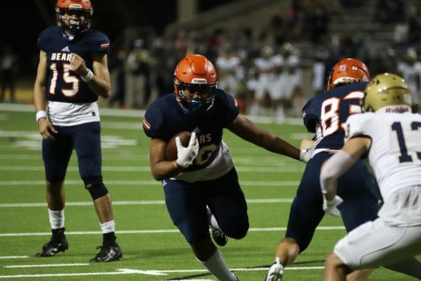 Junior Mason Culton runs in one of his three touchdowns against Klein Collins.