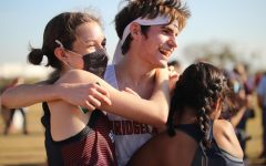 In celebration of the varsity boys cross country's third place finish at the Region cross Country meet, Jacob Grosch, Macie Gunn, and Allison Milan share a hug.