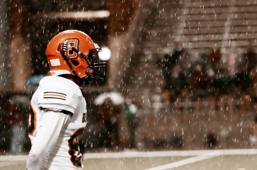 Sophomore Jonathan Nelson stands in the rain at the beginning of the game against Cy-Fair High School.