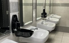 Empty soap dispensers in the boys bathroom